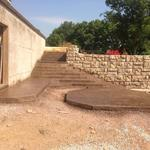 Stamped-concrete steps leading to pool and stamped pad for hot tub